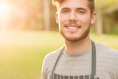 Handsome farmer smiling at camera Royalty Free Stock Photography