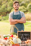 Handsome farmer standing arms crossed Stock Photo