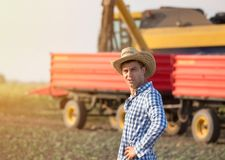 Farmer on field during harvest Royalty Free Stock Images