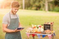 Handsome farmer using his tablet Royalty Free Stock Photography