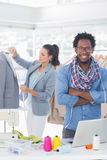Handsome fashion designer with arms crossed Royalty Free Stock Photos