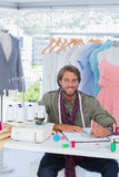 Handsome fashion designer smiling to the camera Stock Photos