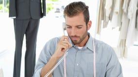 Handsome fashion designer working at his desk stock video