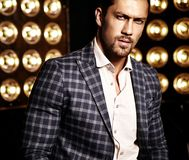 Handsome fashion male model man dressed in elegant suit Stock Image
