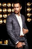 Handsome fashion male model man dressed in elegant suit Stock Photos