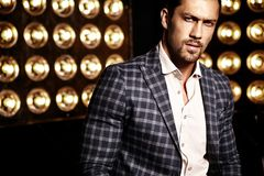 Handsome fashion male model man dressed in elegant suit Stock Images