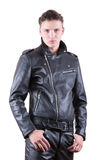 Handsome fashion man, beauty male model portrait wear black leather jacket and pants, young guy on white isolated background. Handsome fashion man, beauty male Stock Images