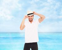 Handsome fashion man in hat, smile Stock Photography