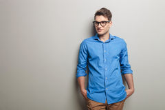 Handsome fashion man holding his hands in pockets. Royalty Free Stock Images
