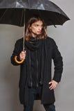 Handsome fashion man portrait wearing black coat. Stock Photography