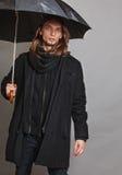 Handsome fashion man portrait wearing black coat. Stock Images