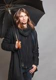 Handsome fashion man portrait wearing black coat. Royalty Free Stock Image
