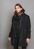 Handsome fashion man portrait wearing black coat. Royalty Free Stock Image