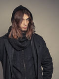 Handsome fashion man portrait wearing black coat. Royalty Free Stock Photo