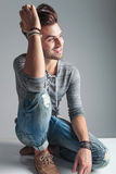 Handsome fashion man smiling and looking away Stock Images