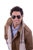Handsome fashion man with sunglasses wearing coat with a scarf Stock Images
