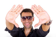 Handsome fashion man with tinted sunglasses posing smiling Royalty Free Stock Photography