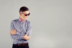 Handsome fashion man wearing sunglasses thinking Royalty Free Stock Images