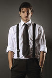 Handsome fashion model with black tie stock images