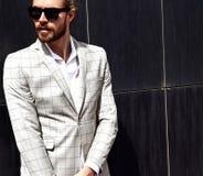 Handsome fashion model man dressed in elegant suit Stock Images