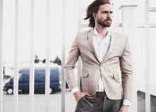Handsome fashion model man dressed in elegant suit Stock Photos