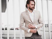 Handsome fashion model man dressed in elegant suit Royalty Free Stock Image