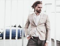 Handsome fashion model man dressed in elegant suit Stock Image
