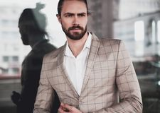 Handsome fashion model man dressed in elegant suit Stock Photography
