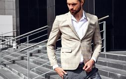 Handsome fashion model man dressed in elegant suit stock photo