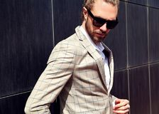 Handsome fashion model man dressed in elegant suit Royalty Free Stock Images
