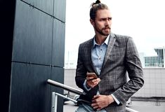 Handsome fashion model man dressed in elegant suit Royalty Free Stock Photography