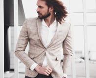 Handsome fashion model man dressed in elegant suit Stock Photo
