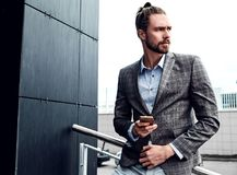 Handsome fashion model man dressed in elegant suit Royalty Free Stock Photo