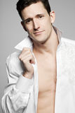 Handsome fashion model posing in white shirt. Royalty Free Stock Image