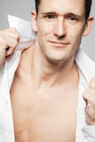 Handsome fashion model posing in white shirt. Stock Photos