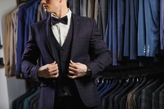 Handsome caucasian businessman dressed in the suit in suit shop Stock Image