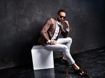 Handsome fashion stylish businessman model dressed in elegant suit Stock Image