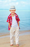 Handsome fashionable kid on the beach. Portrait of handsome fashionable kid on the beach Royalty Free Stock Images