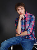 Handsome fashionable man in casual shirt and jeans Stock Photos
