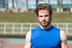 Handsome fashionable man has stylish hair in sportswear, sport fashion. Healthy lifestyle and sport fashion. handsome fashionable man model or bearded sexy guy Royalty Free Stock Photos