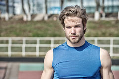 Handsome fashionable man has stylish hair in sportswear, sport fashion. Healthy lifestyle and sport fashion. handsome fashionable man model or bearded sexy guy Royalty Free Stock Photo