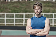 Handsome fashionable man has stylish hair in sportswear, sport fashion Stock Photo