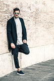 Handsome fashionable man, white bricks wall Royalty Free Stock Photography