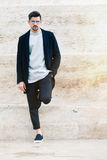 Handsome fashionable man, white wall Stock Image