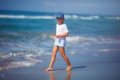 Handsome fashionable young boy are going to swim in the sea during summer vacation stock images