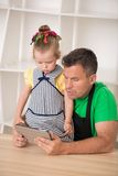 Handsome father and cute little daughter cooking Stock Photo