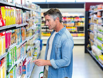 Handsome father doing some shopping Royalty Free Stock Image
