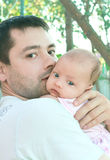 Handsome father holding baby girl Royalty Free Stock Photos