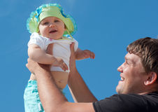Handsome father holding his cute daughter Royalty Free Stock Images