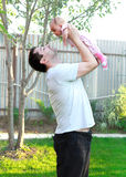 Handsome father holding little baby royalty free stock photo